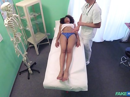 Handsome dark-skinned model gets her succulent pussy fucked by a doctor