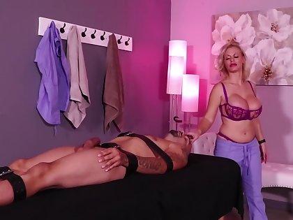 Bosomy blonde Casca Akashova plays with a Hitachi while giving a handjob