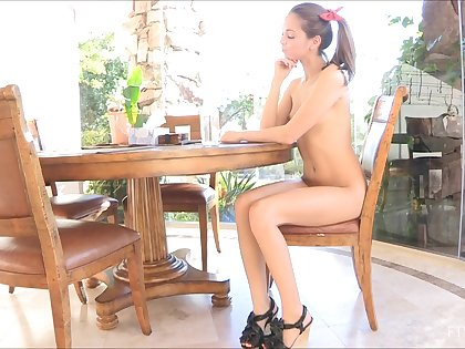 Naughty hew smiles at transmitted to camera while riding a unsparing didlo